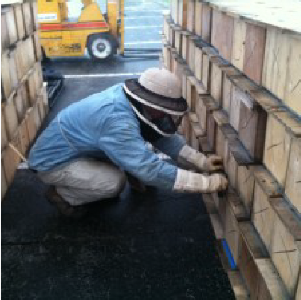 Beekeeper checking nuc boxes after their arrival