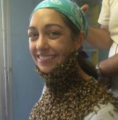Workshop presenter Ana Heck covered by bees on her neck