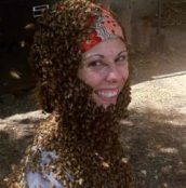 Workshop presenter Becky Masterman covered by bees on her head and neck