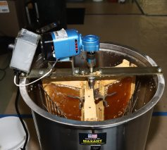 Honey frames loaded in a stainless steel centrifical force extractor