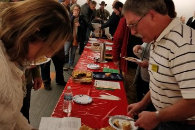 EMBA members tasting recipes made with honey at the EMBA Cooking Competition held each year in November